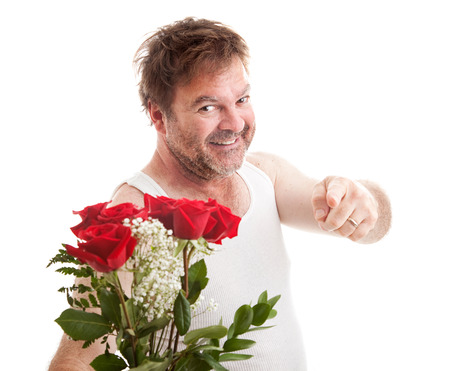 Scruffy looking man in his underwear holding roses and pointing at you.  Isolated on white.