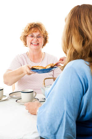 matron: Two mature ladies having a tea party together.  White background