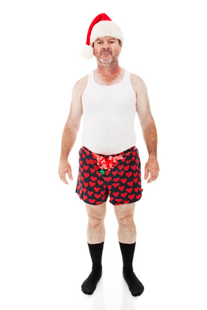 Man in his underwear looking sick, bored, and tired of Christmas.  Full Body isolated on white.