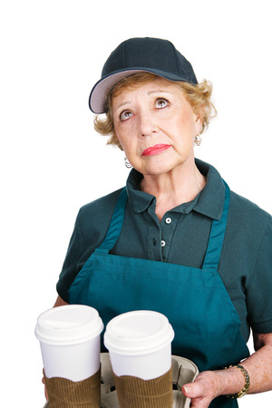 Senior woman serving coffee because she cant afford retirement. Isolated on white.   photo