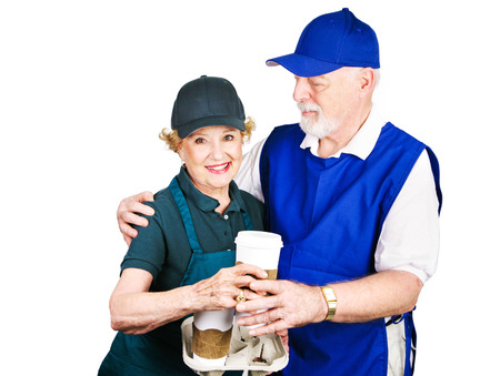 Senior couple working minimum wage jobs to supplement retirement income. Isolated on white.