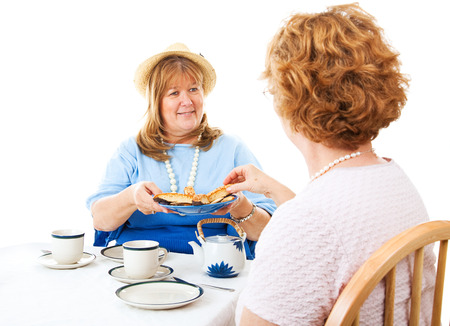 matron: Two mature ladies enjoying a tea party together.  White background.