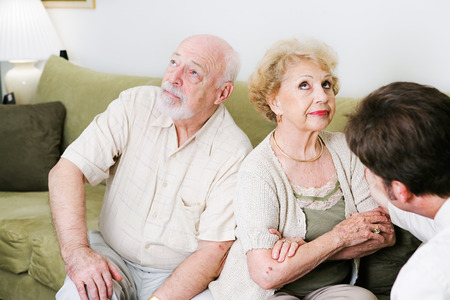 Senior couple seeing a marriage counselor, won't speak to one another.