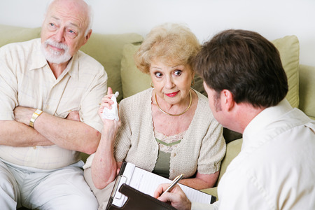 complaining: Senior woman complaining to a marriage counselor about her husband.