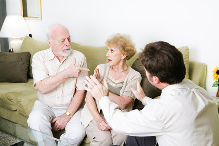 counseling session: Senior couple arguing in a counseling session.  Copyspace for text.   Stock Photo