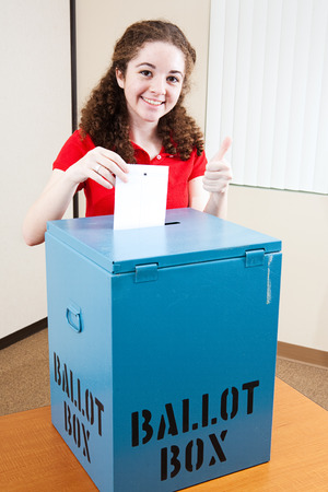 democrat: Pretty 18 year old hispanic American girl voting for the first time.