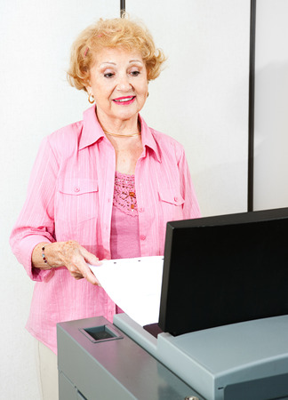 voting: Senior woman using a new optical scanner voting machine to cast her ballot.