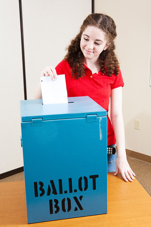 voting: Eighteen year old Latina girl voting for the first time.