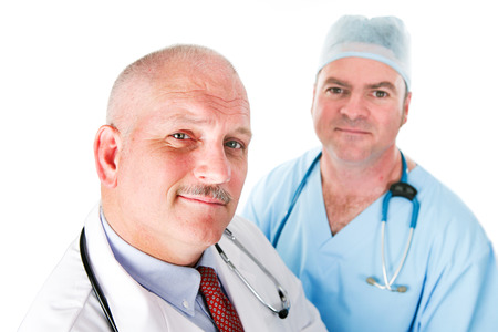Portrait of two handsome doctors, one a mature physician and another young surgeon.
