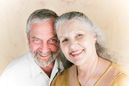 deeply: Portrait of beautiful senior couple in their sixties, still deeply in love.