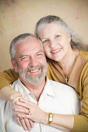 Portrait of beautiful Christian senior couple.  They are married and she is wearing a cross. photo