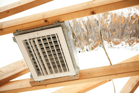 Expoxed air conditioning duct and electrical wiring on a construction site.