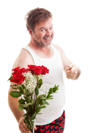 wife beater: Scruffy unshaven husband in his underwear with red roses for Valentines Day.  Isolated on white. Stock Photo