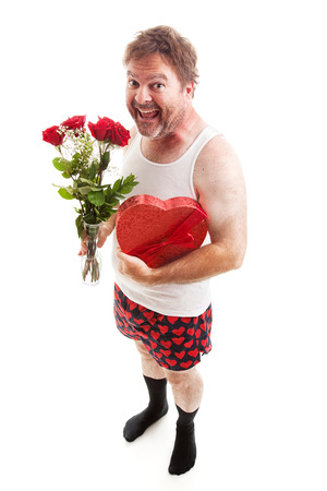 wife beater: Scruffy middle aged man in his underwear with Valentines Day flowers and chocolates for his sweetheart.  Isolated on White Stock Photo