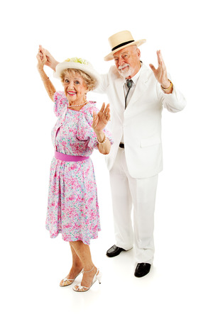 ballroom: Beautiful Southern senior couple dancing together.  Full body isolated on white.