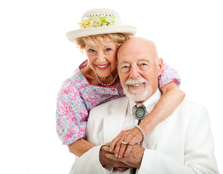 Portrait of beautiful senior couple dressed in Southern style.  Isolated on white. Foto de archivo