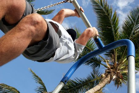pullups: man doing pullups Stock Photo