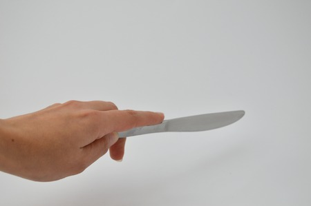 splitting up: hand with knife