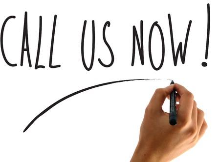 hand writing call us now Banco de Imagens