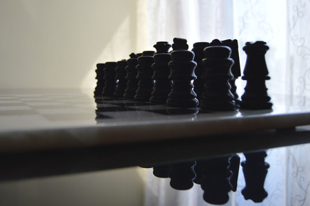 war decoration: chess board with pieces in ceramic blacks and whites