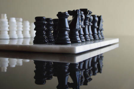 blacks: chess board with pieces in ceramic blacks and whites
