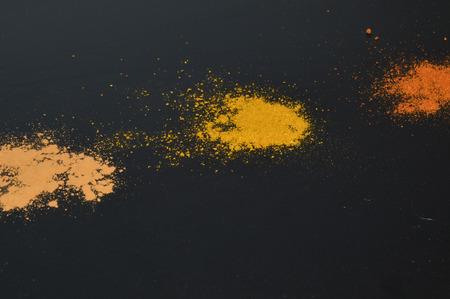 tabasco: Group spice powder on a black background Stock Photo