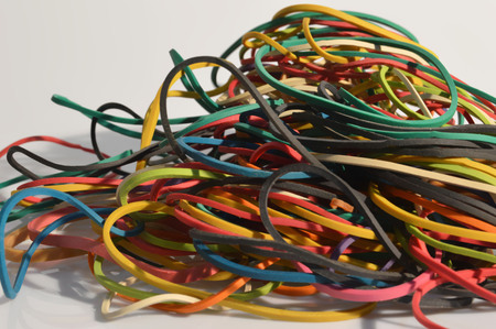 rubber bands: Group of colored rubber bands on white background