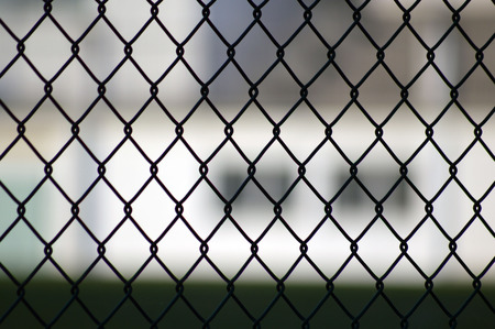 fence: metal grid fence over blurred