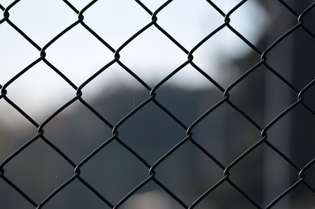 chainlink fence: metal grid fence over blurred