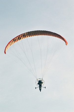 gliding: man with hang gliding in the sky
