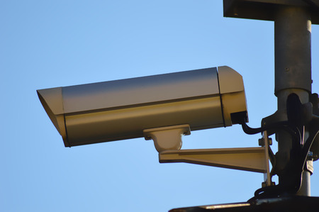 larceny: surveillance camera on blue sky