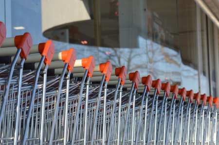 wag: row of shopping carts in front of store