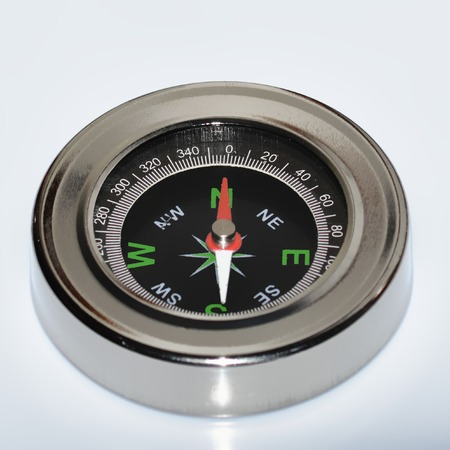 magnetic north: metal compass on a white background Stock Photo
