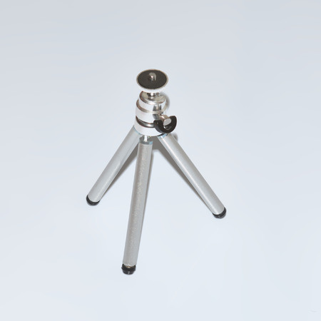 tiny lenses: small metal tripod on white background