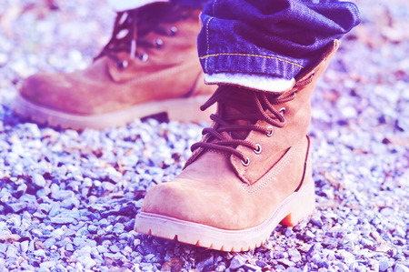 safeness: mountaineer shoes with jeans in nature