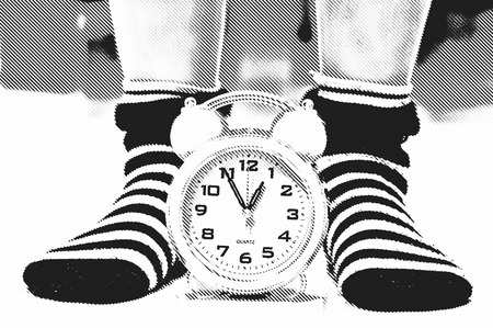 photomontage: photomontage, Pink alarm clock between two feet with socks
