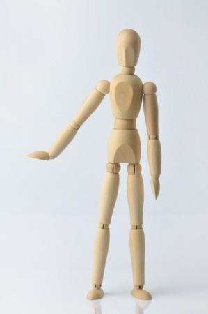 dummy: Single wooden dummy on white background
