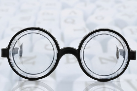 astigmatism: glasses with black frames on white background Stock Photo