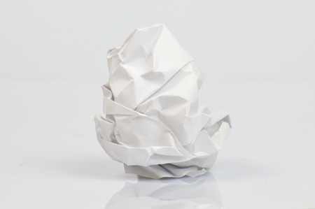 crumpled sheet: Single crumpled sheet of paper on neutral background