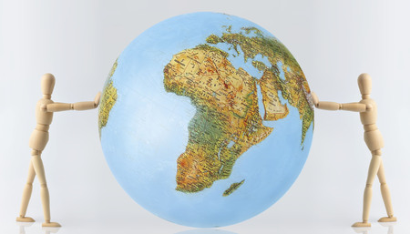 foreign bodies: isolated mannequin with globe on a neutral background