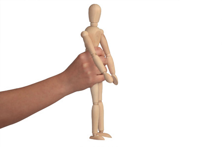 stumbling: hand he is holding up a mannequin on a white background Stock Photo