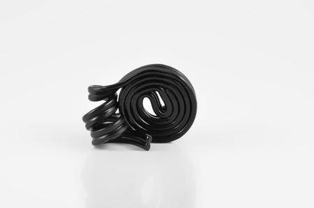 licorice: spiral of black licorice on white background Stock Photo