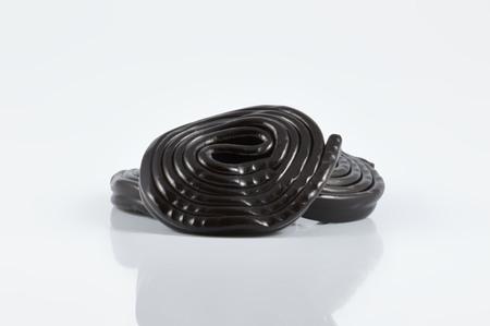 licorice: group of black licorice on white background Stock Photo