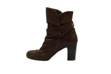 heel strap: Single leather boot on background