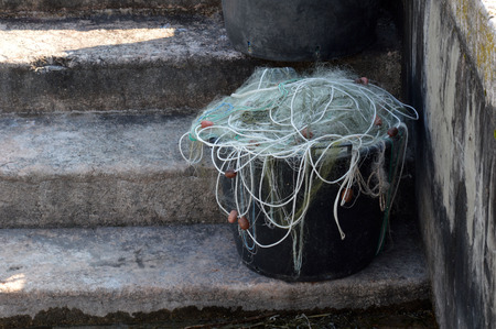 concrete steps: canister with fishing net on concrete steps