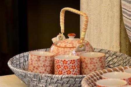 tea service: ceramic tea service in braided basket