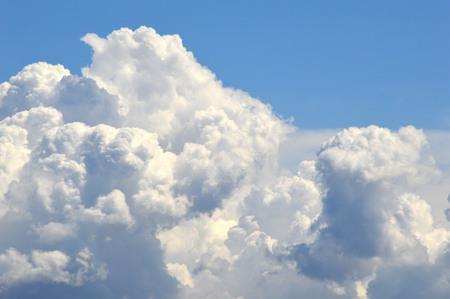fluffy: fluffy white cloud on blue sky