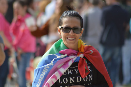 rainbow flag: smiling girl with rainbow flag on blurred background