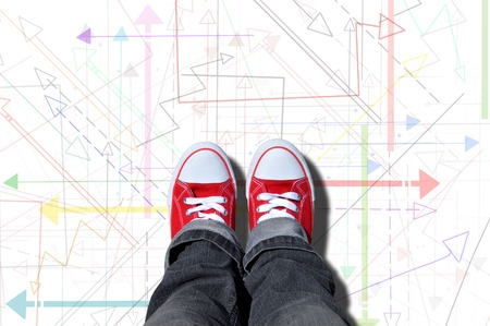 multidirectional: red sneakers on yellow background with multi-directional arrows