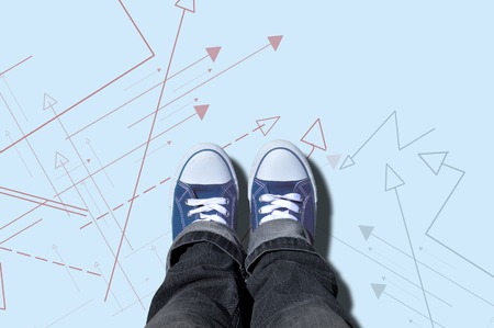 multidirectional: blue sneakers on yellow background with multi-directional arrows